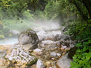 Misty floats across rocks and flowing water. Krajcarica Creek is in Zadnjica Valley, a short (3.5km), very-steep-sided offshoot of the Trenta valley which descends directly from Mount Triglav (2864 meters/9396 feet), the highest peak of the Julian Alps, Europe. Mount Triglav is proudly depicted on the Slovenian coat of arms and flag. Triglav is the only National Park in Slovenia (in Slovene: Triglavski narodni park, TNP).