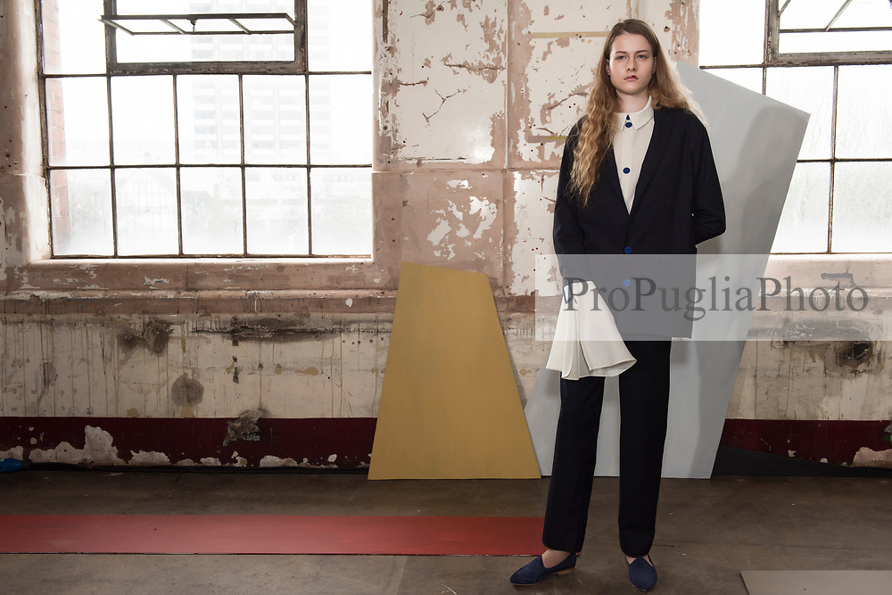 """London 18 February 2017, Edeline Lee Autumn Winter presentation at Oxo Tower during London Fashion Week AW17. Canadian-born, London-based EDELINE LEE graduated with a First from Central Saint Martins Womenswear and apprenticed in the studios of Alexander McQueen and John Galliano before working at Zac Posen in New York and as Head Designer for Rodnik in London. An unintentional soft launch led to a flurry of private orders and the birth of her eponymous collection in 2014. The designer has stated that she designs for the """"Future Lady"""": her work has been worn by stars like Alicia Vikander, Taylor Swift, Holland Roden and Solange Knowles. She has also received strong support from the women of the art world, who naturally gravitate towards her aesthetically sophisticated signature. <br />  <br /> Edeline Lee has been awarded support by the Centre for Fashion Enterprise and has been two times Finalist for the Samsung Fashion & Design Fund. Her work was recently exhibited by the curators of the Fashion Space Gallery to represent the """"Future of Fashion Presentation"""". She is currently nominated for Breakthrough Womenswear Designer of the Year at the WGSN Fashion Futures Awards. <br />  <br /> Spring Summer 2016 was her debut season on the official London Fashion Week schedule of the British Fashion Council. All Edeline Lee pieces are made of the finest French and Italian cloths, by hand in England."""