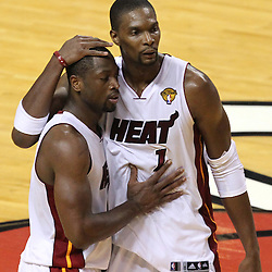Jun 19, 2012; Miami, FL, USA; Miami Heat shooting guard Dwyane Wade (3) and power forward Chris Bosh (1) react during the fourth quarter against the Oklahoma City Thunder in game four in the 2012 NBA Finals at the American Airlines Arena. Mandatory Credit: Derick E. Hingle-US PRESSWIRE