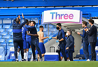 Football - 2019 / 2020 Premier League - Chelsea vs. Wolverhampton Wanderers<br /> <br /> Chelsea Manager Frank Lampard (back to camera) claps as they secure Champions League football for next season with a 2-0 defeat of Wolverhampton Wanderers, at Stamford Bridge.<br /> <br /> COLORSPORT/ASHLEY WESTERN