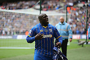 AFC Wimbledon striker Adebayo Akinfenwa (10) celebrates during the Sky Bet League 2 play off final match between AFC Wimbledon and Plymouth Argyle at Wembley Stadium, London, England on 30 May 2016.