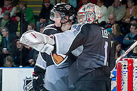 KELOWNA, CANADA - JANUARY 4: Payton Lee G #1 of the Vancouver Giants discusses a play with a teammate at the Kelowna Rockets on January 4, 2014 at Prospera Place in Kelowna, British Columbia, Canada.   (Photo by Marissa Baecker/Shoot the Breeze)  ***  Local Caption  ***