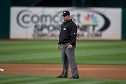 OAKLAND, CA - JUNE 10:  MLB umpire Doug Eddings #88 stands on the field during the first inning between the Oakland Athletics and the Texas Rangers at O.co Coliseum on June 10, 2015 in Oakland, California. The Oakland Athletics defeated the Texas Rangers 5-4. (Photo by Jason O. Watson/Getty Images) *** Local Caption *** Doug Eddings