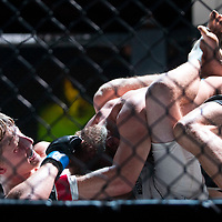 Gregory Bernardi of Starkville, right, pins down Noah Waalk of Senatobia during their MMA fight on Saturday, August 5th during the Summit Fighting Championships match at the Tupelo Furniture Market. Their match was one of 17 that took place that night.