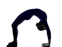 woman exercising Urdhva Dhanurasana bridge pose yoga silhouette shadow white background