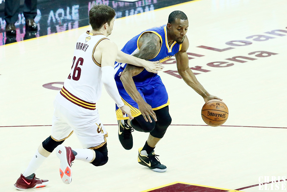 09 June 2017: Golden State Warriors forward Andre Iguodala (9) drives past Cleveland Cavaliers guard Kyle Korver (26) during the Cleveland Cavaliers 137-11 victory over the Golden State Warriors, in game 4 of the 2017 NBA Finals, at  the Quicken Loans Arena, Cleveland, Ohio, USA.