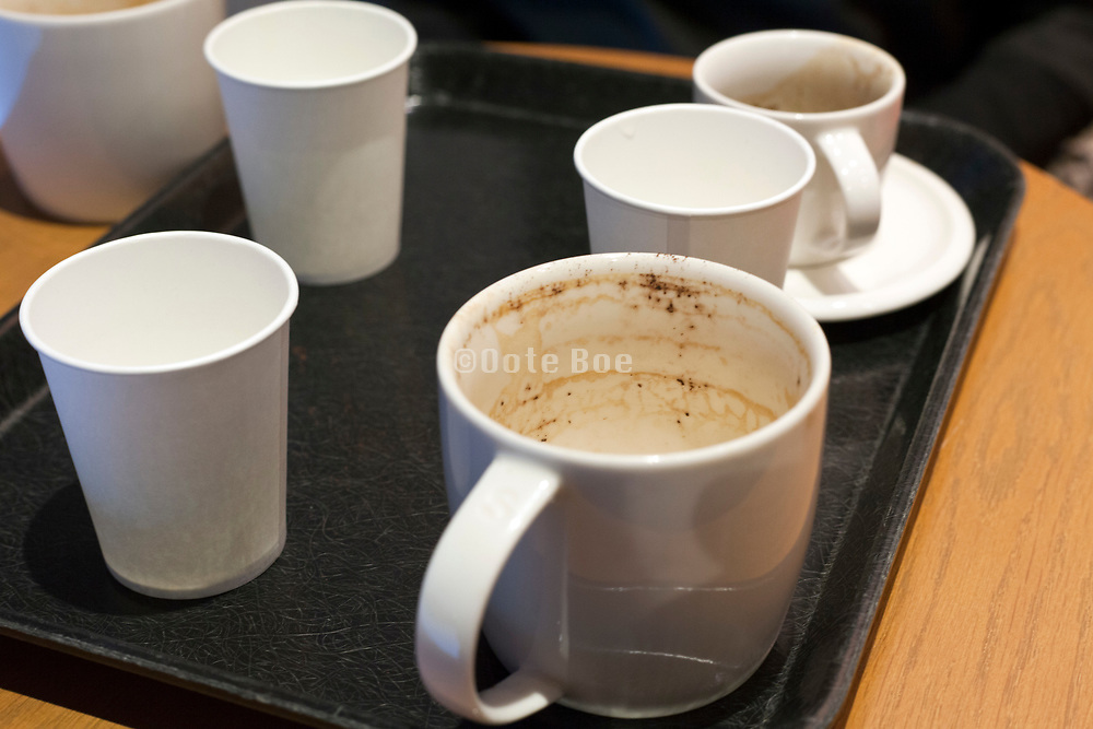 empty coffee and paper cups on a tray
