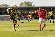 Burton Albion midfielder on loan from Birmingham City Mark Duffy crosses the ball that Coventry City defender Aaron Martin turns into his own net during the Sky Bet League 1 match between Burton Albion and Coventry City at the Pirelli Stadium, Burton upon Trent, England on 6 September 2015. Photo by Simon Davies.