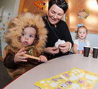"The ""Cowardly Lion"" Nicholas Ide and his sister ""Dorothy"" Braelyn Ide make Ghost pops with help from mom (Kim Ide) during Gilford Library's annual Halloween Parade and Party on Wednesday morning.   (Karen Bobotas/for the Laconia Daily Sun)"