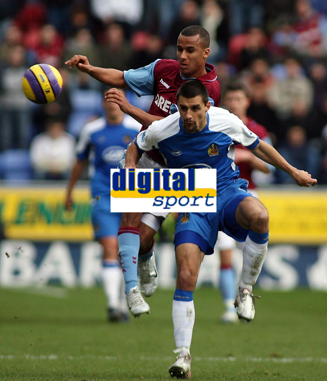Photo: Paul Thomas.<br /> Wigan Athletic v Aston Villa. The Barclays Premiership. 19/11/2006.<br /> <br /> Gabriel Agbonlahor of Aston Villa (Maroon) tries to get past Paul Scharner (Blue).