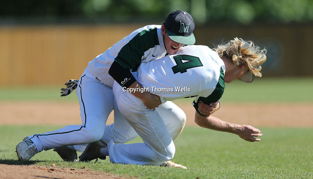 Mooreville pitcher Hayden Hankins gets tackled on the mound after picthing a complete game 6-1 win over Kossuth on Sunday to advance the Troopers to Jackson for the State Championship.