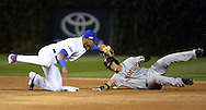 CHICAGO, IL - OCTOBER 7:  Addison Russell #27 of the Chicago Cubs tags out Gorkys Hernandez #66 of the San Francisco Giants as Hernandez attempted to steal second base in the first inning of Game 1 of NLDS at Wrigley Field on Friday, October 7, 2016 in Chicago, Illinois. (Photo by Ron Vesely/MLB Photos via Getty Images) *** Local Caption *** Addison Russell; Gorkys Hernandez
