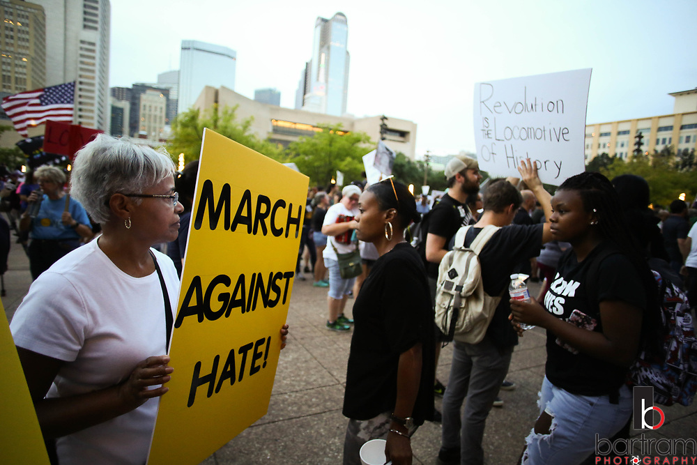 Elaine White of McKinney carries a sign during an anti white-supremacy rally at Dallas City Hall plaza on Saturday, Aug. 19, 2017. White accompanied Rev. Martin Luther King in his March on Washington DC when she was 16. (Photo by Kevin Bartram)