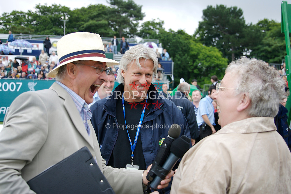 Liverpool, England - Wednesday, June 13, 2007: Bjorn Borg on a rainy and wet centre court at Calderstones as he is interviewed by Radio Merseyside's Alan Jackson and a fan during action on day two of the Liverpool International Tennis Tournament. Bjorn was scheduled to play his first match on grass since 1981 but was forced to withdraw after a dog bit his leg. For more information visit www.liverpooltennis.co.uk. (Pic by David Rawcliffe/Propaganda)
