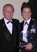 Staff Sergeant Stacy Pearsall receives the Military Photographer of the Year Award from Secretary of Defense Donald Rumsfeld at the White House Press Photographers dinner in Washington D.C.