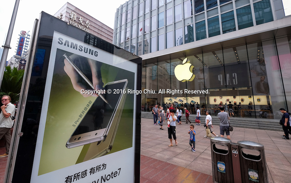 "An billboard advertising Samsung Galaxy Note 7 stands in front of an Apple Store in the Nanjing Road Pedestrian Street on September 5, 2016, in Shanghai, China. Nanjing Road is the main shopping street of Shanghai, China, and is one of the world's busiest shopping streets. The street is named after the city of Nanjing, capital of Jiangsu province neighbouring Shanghai. Today's Nanjing Road comprises two sections, Nanjing Road East and Nanjing Road West. In some contexts, ""Nanjing Road"" refers only to what was pre-1945 Nanjing Road, today's Nanjing Road East, which is largely pedestrianised. Before the adoption of the pinyin romanisation in the 1950s, its name was rendered as Nanking Road in English. Shanghai is the most populous city in China and the most populous city proper in the world. It is one of the four direct-controlled municipalities of China, with a population of more than 24 million as of 2014. It is a global financial centre, and a transport hub with the world's busiest container port. Located in the Yangtze River Delta in East China, Shanghai sits on the south edge of the mouth of the Yangtze in the middle portion of the Chinese coast. The municipality borders the provinces of Jiangsu and Zhejiang to the north, south and west, and is bounded to the east by the East China Sea. A major administrative, shipping, and trading town, Shanghai grew in importance in the 19th century due to trade and recognition of its favourable port location and economic potential. The city was one of five forced open to foreign trade following the British victory over China in the First Opium War while the subsequent 1842 Treaty of Nanking and 1844 Treaty of Whampoa allowed the establishment of the Shanghai International Settlement and the French Concession. The city then flourished as a center of commerce between China and other parts of the world (predominantly Western countries), and became the primary financial hub of the Asia-Pacific region in the 1930s. However, with th"