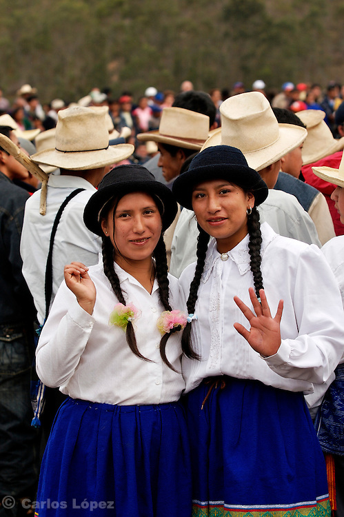 TWO YOUNG WOMEN WEARING TRADITIONAL CLOTHES AT THE HATUN LUYA FESTIVAL., .   The Hatun Luya is a festival celebrated every september 13th, where everyone from the surrounding areas comes together. During this festivity, you can witness demonstrations of popular customs.