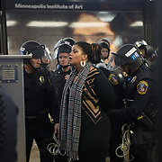 Black Lives Matter leader Nicque Mabrey, is arrested by Bloomington police after they pushed protesters out of the airport and back onto the light rail platform at the Minneapolis-St. Paul International Airport's Terminal 2 during a day of protests on December 23, 2015. Officers had issued warnings that those who did not depart on one of the two trains in the station would be arrested. <br />