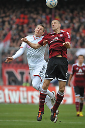 31.03.2012, Easy-Credit-Stadion, Nuernberg, GER, 1. FBL, 1. FC Nuernberg vs FC Bayern Muenchen, 28. Spieltag, im Bild Bastian Schweinsteiger (Bayern Muenchen/ links) im Kopfballduell mit Timmy Simons (1.FC Nuernberg/ rechts). Action / Aktion // during the German Bundesliga Match, 28th Round between 1. FC Nuernberg and FC Bayern Munich at the Easy-Credit-Stadium, Nuernberg, Germany on 2012/03/31. EXPA Pictures © 2012, PhotoCredit: EXPA/ Eibner/ Matthias Merz..***** ATTENTION - OUT OF GER *****