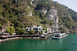 Riverside structures introduce a re-created traditional water village on the Yangtze River's Mingyue Bay, a shore excursion for tourists cruising the river between Jingzhou and Chongqing.  It is on the site of Hama Spring, lauded by Chinese poets for its beauty and clarity through more than 10 centuries.