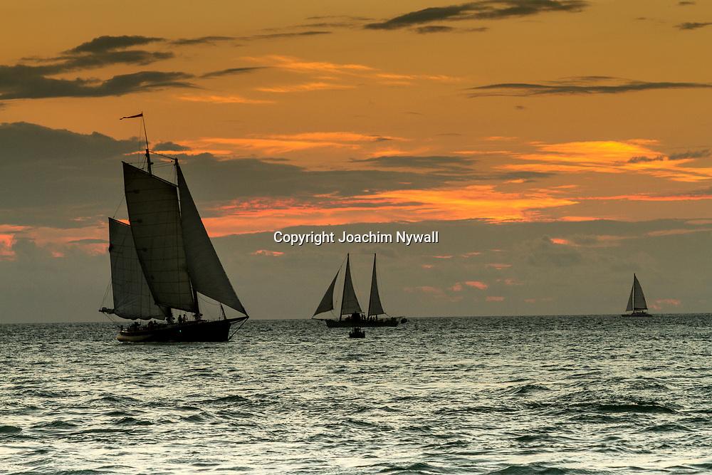 Key West 2015 11 23 Florida<br /> Utsikt vid Sunset pier i Key West<br /> b&aring;tar som seglar i solnedg&aring;ngen<br /> <br /> FOTO : JOACHIM NYWALL KOD 0708840825_1<br /> COPYRIGHT JOACHIM NYWALL<br /> <br /> ***BETALBILD***<br /> Redovisas till <br /> NYWALL MEDIA AB<br /> Strandgatan 30<br /> 461 31 Trollh&auml;ttan<br /> Prislista enl BLF , om inget annat avtalas.