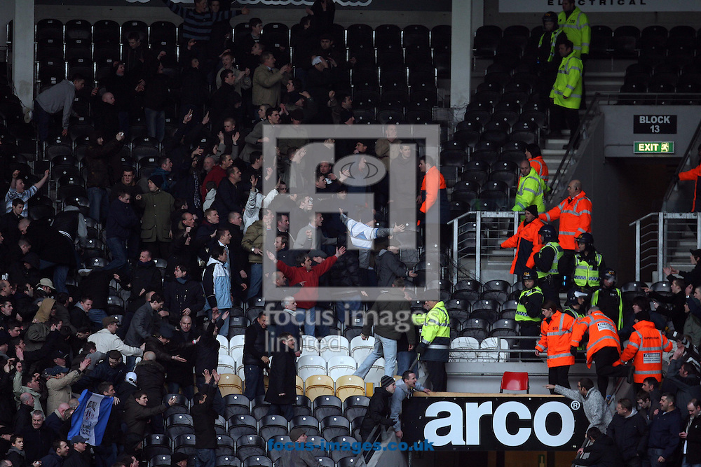 Hull - Saturday, January 24th, 2009:  Hull City and Millwall fans taunt each other before and during the game leading to some fans being removed from the stadium during the FA Cup fourth round match at the KC Stadium, Hull. (Pic by Darren Walker/Focus Images)