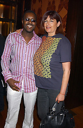 MR & MRS ORLANDO HAMILTON at a party to celebrate the publication of Air Babylon by Imogen Edwards-Jones held at Fifty, 50 St.James's Street, London SW1 on 4th July 2005.<br />