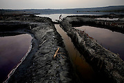 Channels lead from the main lake supply the pans with salt water, at Lake Katwe, Uganda, on Friday, Dec. 28, 2007..