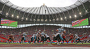 Carolina Panthers quarterback Kyle Allen (7) fakes a pass to  running back Christian McCaffrey (22) during the first quarter of the NFL International Series game against the Tampa Bay Buccaneers at Tottenham Hotspur Stadium, Sunday, Oct. 13, 2019, in London.  The Panthers defeated the Buccaneers 37-26. (Gareth Williams/Image of Sport)