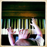 I took classical piano lessons for nine years, and have neglected practicing since Quinn was born. I'm playing with him here, as he pounds on the keys.