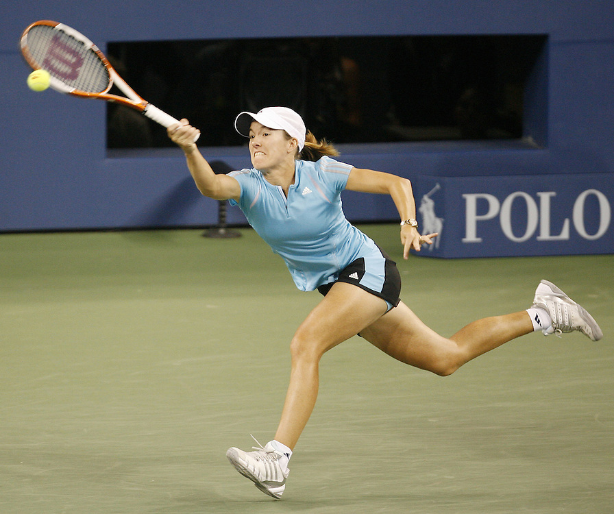 Justine Henin-Hardenne of Belgium hits a forehand return to Maria Sharapova of Russia during the women's final on the thirteenth day of the 2006 US Open tennis tournament in Flushing Meadows, New York Saturday, 09 September 2006.