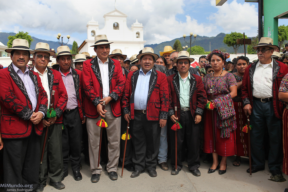 Nebaj Mayor Pedro Raymundo Cobo (center), also known as Pap Lu, along with other Ixil Mayan authorities, prepare to walk towards the home where the Confraternity of San Antonio will give way to the seven-day festivities honoring Saint Anthony of Padua. The Confraternity of San Antonio is one of only 5 remaining brotherhoods in Nebaj that syncretize local spiritual beliefs with those imposed by the Catholic Faith from the 16th century on. Some Ixil Mayan scholars associate the veneration of Saint Anthony as symbolic to a celebration of children and hence, the future. Nebaj, Quiche, Guatemala. June 06, 2013.