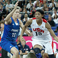 11 August 2012: USA Candace Parker drives past Elodie Godin during 86-50 Team USA victory over Team France, during the Women's Gold Medal Game, at the North Greenwich Arena, in London, Great Britain.