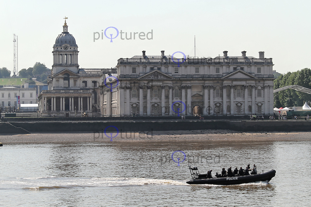 LONDON - JULY 25: Metropolitan Police Marine Support Units & British Military patrol the River Thames providing London 2012 Olympics Security. July 25, 2012. (Photo by Richard Goldschmidt)