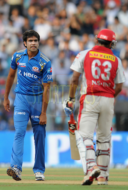 Munaf Patel of Mumbai Indians exchange a word with Nitin Saini of Kings XI Punjab during match 28 of the Indian Premier League ( IPL) 2012  between The Mumbai Indians and the Kings X1 Punjab held at the Wankhede Stadium in Mumbai on the 22nd April 2012..Photo by Pal Pillai/IPL/SPORTZPICS.