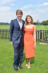 TOM HOOPER and GEMMA ARTERTON at the Audi International Polo at Guards Polo Club, Windsor Great Park, Egham, Surrey on 26th July 2014.