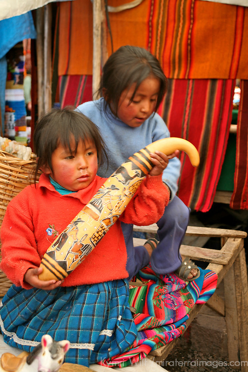 Americas, South America, Peru, Pisac. Two very young girls help with sales at Pisac market.