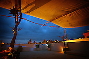 "SHOT 2/11/09 7:30:16 PM - Dusk settles in on the upper balcony of the Petit Hotel Hafa in Sayulita, Mexico. Located on Calle Jose-Mariscal in Sayulita Mexico, Petit Hotel d'Hafa is a quaint boutique hotel just steps away from the Sayulita plaza and less than a two minute stroll to the beach and surfing break. Sayulita is a small fishing village about 25 miles north of downtown Puerto Vallarta in the state of Nayarit, Mexico. Known for its consistent river mouth surf break, roving surfers ""discovered"" Sayulita in the late 60's with the construction of Mexican Highway 200. Today, Sayulita is a prosperous growing village of approximately 4,000 residents. Hailed as a popular off-the-beaten-path travel destination, Sayulita offers a variety of activities such as horseback riding, hiking, jungle canopy tours, snorkeling and fishing. Still a mecca for beginner surfers of all ages, the quaint town attracts upscale tourists with its numerous art galleries and restaurants as well. Sayulita has a curious eclectic quality, frequented by native Cora and Huichol peoples, travelling craftsmen as well as international tourists. Sayulita is the crown jewel in the newly designated ""Riviera Nayarit"", the coastal corridor from Litibu to San Blas. It's stunning natural beauty and easy access to Puerto Vallarta have made Sayulita real estate some of the most sought after in all of Mexico..(Photo by Marc Piscotty / © 2009)"