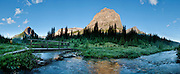 A bridge crosses a tributory of Pharaoh Creek at Egypt Lake Campsite, in Banff National Park, Alberta, Canada. This is part of the big Canadian Rocky Mountain Parks World Heritage Site declared by UNESCO in 1984. Panorama stitched from 7 images.