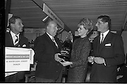19/01/1963<br /> 01/19/1963<br /> 19 January 1963<br /> Lord mayor draws raffle prizewinner at Mansion House, Dublin.  At the conclusion of the Irish Hotel and Catering Trades Exhibition at the Mansion House, Lord Mayor Alderman J.J. O'Keeffe, T.D., P.C. drew the winning ticket in aid of the Royal Hospital for Incurables, Donnybrook, Dublin for a Lanson Black Label Methuselah, presented by Edward Dillon and Co. Ltd. The proceeds of £50 were presented to the Mayor for donation to the hospital. Picture shows the Lord Mayor  Dublin model, Olive White