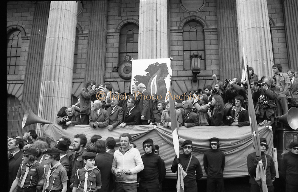 Sinn Fein (Provo) Dublin Parade.   K22..1976..25.04.1976..04.25.1976..25th April 1976..Sinn Fein held an Easter Rising Commemorative  parade..The parade started at St Stephens Green, Dublin and proceeded through the streets to the G.P.O.in O'Connell Street, the scene of the centre of the 1916 uprising..Image shows photographers vastly outnumbering the delegates on the reviewing stand.