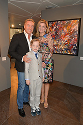 MICHAEL FLATLEY with his wife NIAMH and their son MICHAEL at a private view of paintings by Michael Flatley entitled Firedance held at 12 hay Hill, London on 24th June 2015.