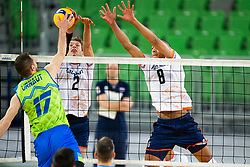 30-12-2019 SLO: Slovenia - Netherlands, Ljubljana<br /> Tine Urnaut of Slovenia, Wessel Keemink and Fabian Plak of the Netherlands during friendly volleyball match between National Men teams of Slovenia and Netherlands.