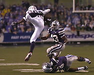 Florida Atlantic tight end Jason Harmon (88) is sent airborn after getting tripped up by Kansas State defensive back Kyle Williams (9) in the second half as Wildcat Antwon Moore moves in, at Bill Snyder Family Stadium in Manhattan, Kansas, September 9, 2006.  The Wildcats beat the Owls 45-0.