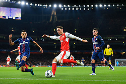 Mesut Ozil of Arsenal is challenged by Marquinhos of Paris Saint-Germain - Rogan Thomson/JMP - 23/11/2016 - FOOTBALL - Emirates Stadium - London, England - Arsenal v Paris Saint-Germain - UEFA Champions League Group A.