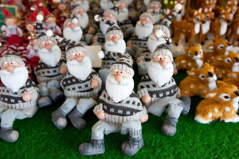 Christmas ornaments of Father Christmas at traditional outdoor Christmas market at Viktualienmarkt in Munich, Bavaria, Germany