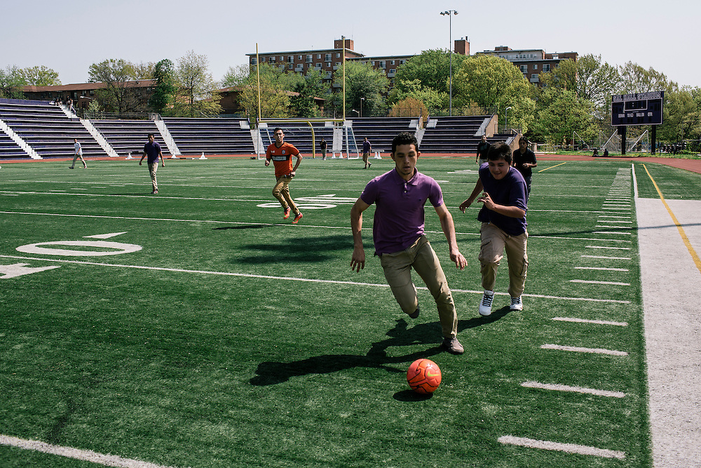 Students in Washington D.C.'s first-year International Academy for English-language learners, including  William Axume, 17, originally from Honduras, play a game of soccer during their lunch hour on the school turf at the International Academy at Cardozo Education Campus on April 22, 2015. The program is aimed at dealing with the influx of unaccompanied minors, mostly from Central American countries, and allows them to be in classes of 25 together. Currently Cardozo, in NW Washington DC has about 200 of these students.