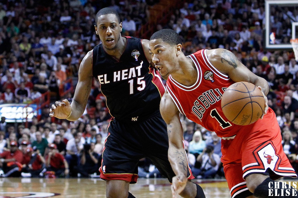 06 March 2010: Chicago Bulls point guard Derrick Rose (1) drives past Miami Heat point guard Mario Chalmers (15) during the Chicago Bulls 87-86 victory over the Miami Heat at the AmericanAirlines Arena, Miami, Florida, USA.