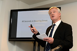 Former chief whip Andrew Mitchell's lawyer Stephen Parkinson (pictured) watches the CCTV footage from Downing Street during a press conference in Farringdon to give his reaction on the Crown Prosecution Service's decision on the 'Plebgate' row, accompanied by his wife, Dr Sharon Bennett (right),  David Davies MP and Stephen Parkinson.  Tuesday, 26th November 2013. Picture by Ben Stevens / i-Images