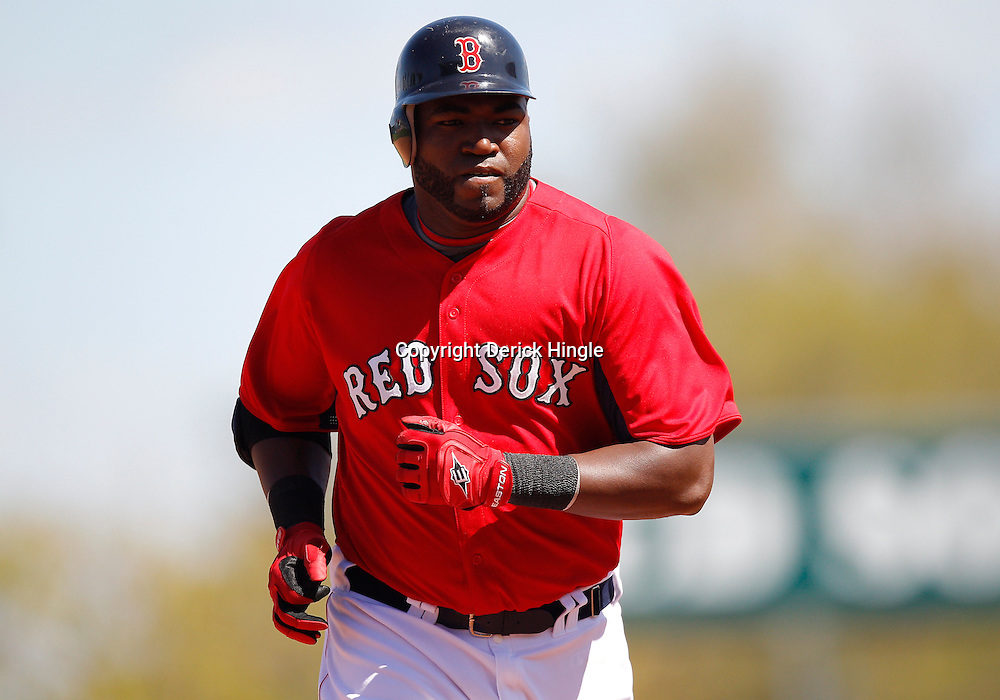 February 28, 2011; Fort Myers, FL, USA; Boston Red Sox first baseman David Ortiz (34) rounds the bases after hitting a homerun during a spring training exhibition game against the Minnesota Twins at City of Palms Park.  Mandatory Credit: Derick E. Hingle